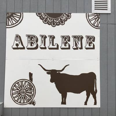 Partnering with other groups; this sign was made for Old Abilene Town.