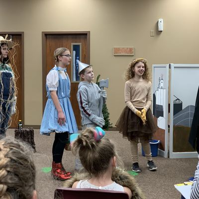 4-Hers put on a skit during 4-H Day about how important 4-H is to them, using a Wizard of Oz theme!